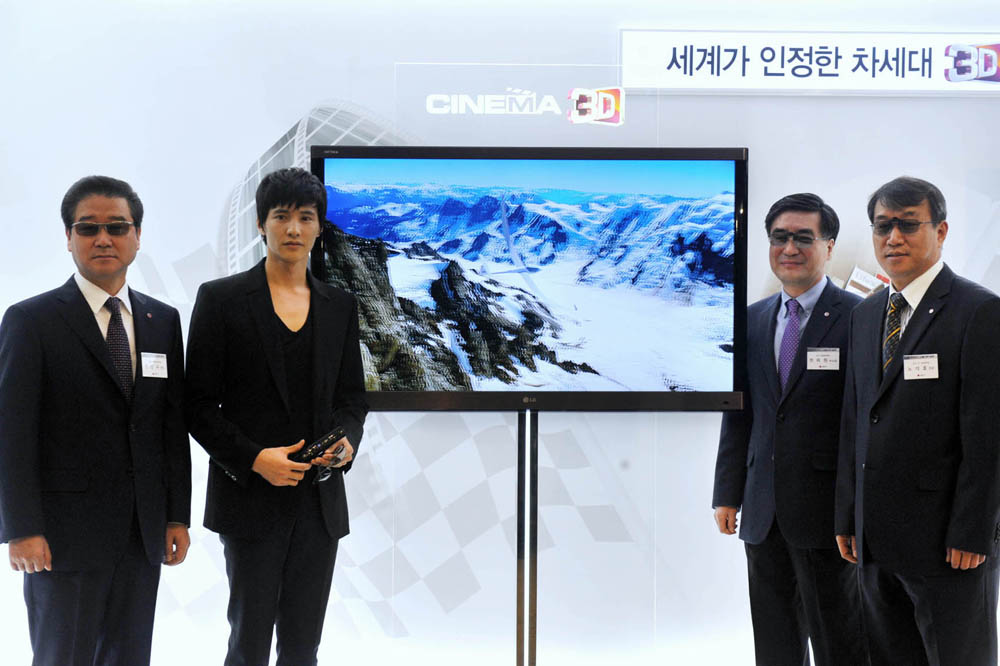 Marketing image of four people flanking LG's NEW CINEMA 3D TV
