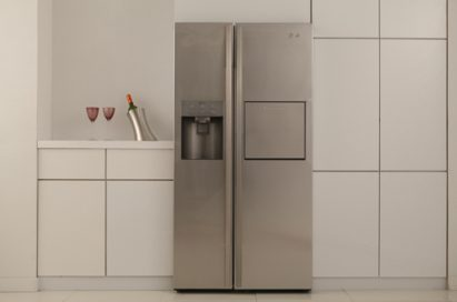 Front view of the LG Side-by-Side Refrigerator placed in a modern kitchen