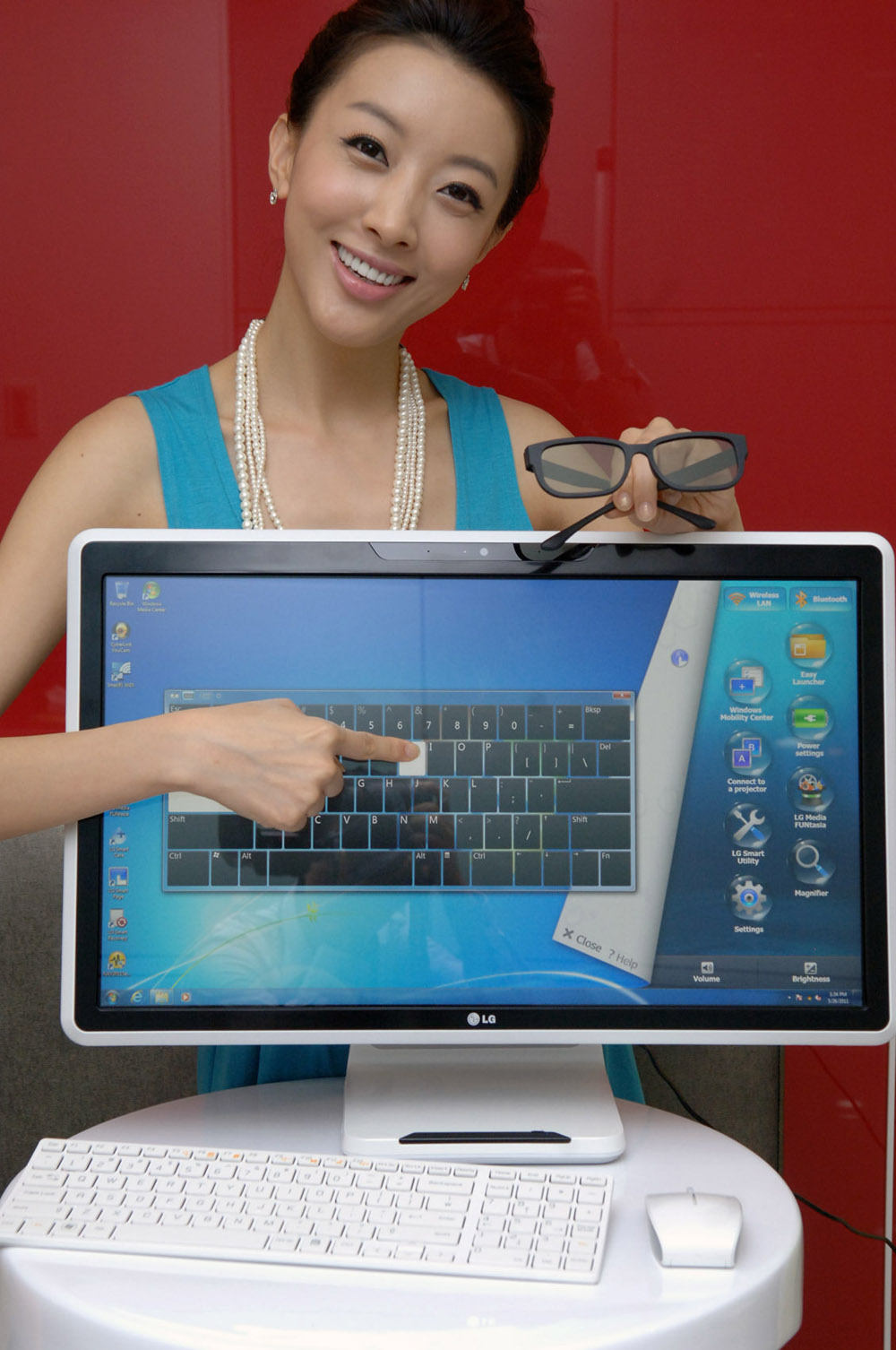 Marketing image of a model pointing at the touch screen of the LG ALL-IN-ONE PC
