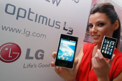 Another view of a female model holding an LG new Optimus L3 designed by the L Style design