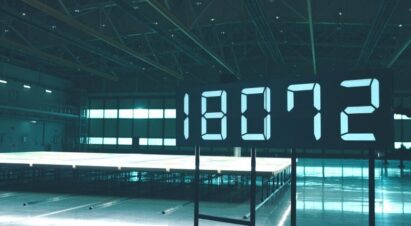 A display showing '18,072' – the number of individual fluorescent bulbs used to create a giant 12-meter-by-9.6-meter image