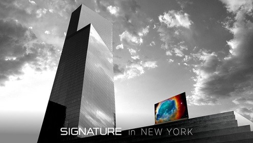 LG SIGNATURE OLED TV with Picture-on-Glass design next to the reflective glass of 4 World Trade Center building in New York