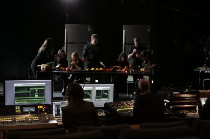 The London Vegetable Orchestra record music using the vegetable instruments they made from LG refrigerated food, with two displayed in the background and a music studio overlooking.