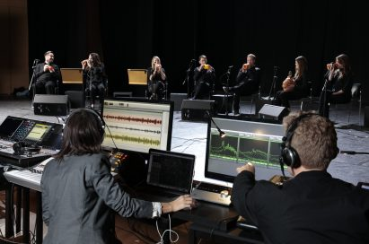 A recording studio records the London Vegetable Orchestra's performance.