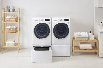 One LG washing machine with the TWINWash™ Mini unit open next to LG dryer with the pedestal unit closed in a laundry room