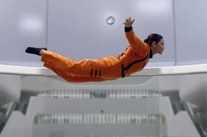 "A screenshot of LG India's ""Astronaut"" video, there are a woman who in in an astronaut training inside a special facility."