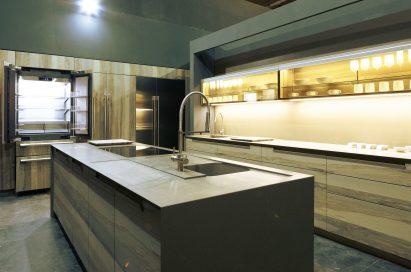 A kitchen with SIGNATURE KITCHEN SUITE built-in appliances