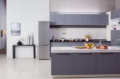 Kitchen with LG Centum System™ bottom-freezer refrigerator in the background