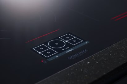 Close-up view of SIGNATURE KITCHEN SUITE cooktop control panel