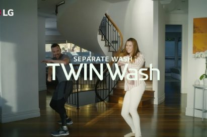 A screenshot from the LG TWINWash Dance Challenge video clip, a man and a woman dance to the music with smiles on their faces