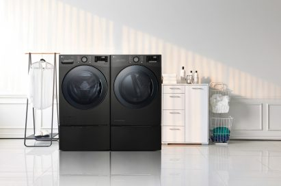 LG TWINWash™ washing machine and dryer in a laundry room