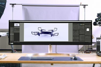 LG UltraWide showing a larger picture taken by two directors on its expansive screen in a studio