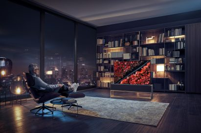A gentleman watching his LG SIGNATURE OLED TV R model 65R9 at Full View in his living room