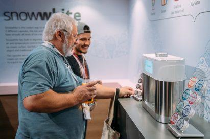 Delegates take a demo of LG's personal ice cream maker prototype, snowwhite.