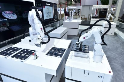 6-axis robot utilizing Automated Guided Vehicle (AGV) on display.