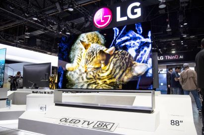 An LG 8K OLED TV showing a vivid image of kittens