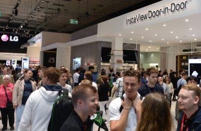 A front view of LG's booth at IFA 2019, there are many visitors looking around the booth.