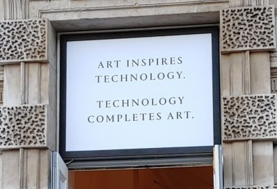 "An LG-sponsored billboard saying, ""Art Inspires Technology. Technology Completes Art."""