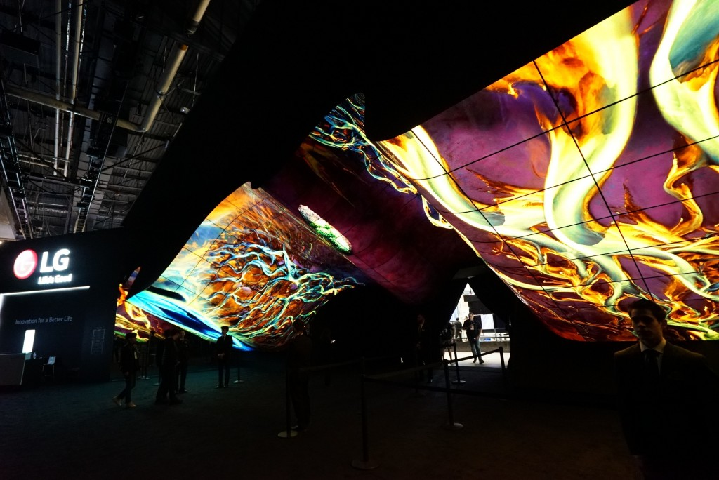 A wide-angle shot of LG Wave in the dark displaying colorful purple, yellow, orange and blues at CES 2020