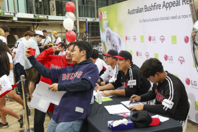 Fans from LG Australia take pictures with the LG Twins players