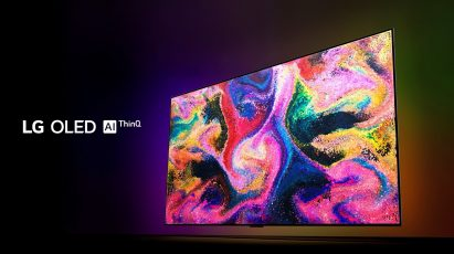 Right side view of LG OLED TV GX emitting vivid, punchy colors in the dark, with the LG OLED AI ThinQ logo on the left