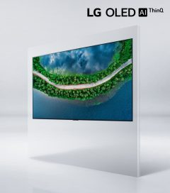 Right side view of LG OLED TV GX displaying a coastal road surrounded by trees, with the LG OLED AI thinQ logo above