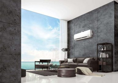 LG DUAL COOL placed on the wall of a modern living room by the ocean