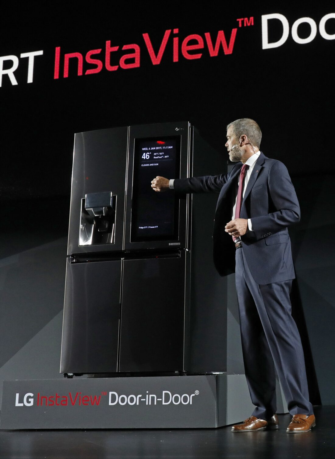 David VanderWaal, Senior Vice President, Marketing, LG Electronics demonstrates the InstaView feature of LG's InstaView Door-in-Door refrigerator at its CES 2017 Press Conference.
