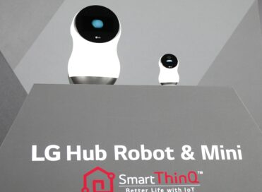 LG's CLOi Hub Robot and CLoi Mini are placed on a display stand at LG's CES 2017 Press Conference.