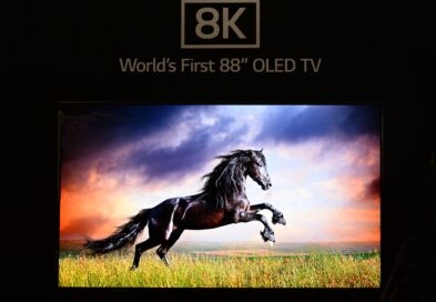 Front close-up view of World's First 8K OLED TV display at IFA 2018, showing a leaping horse on the screen