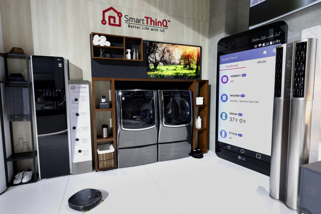 The LG Smart ThinQ zone with LG's AI-powered smart appliances and a large smartphone mock-up to demonstrate how to use an Smart ThinQ app to control appliances