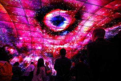 Visitors look up at the displays of the LG OLED Tunnel and admire the incredible picture quality of OLED at LG's CES 2017 booth.