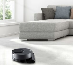 LG CordZeroThinQ vacuuming the living room carpet via the ThinQ™ app