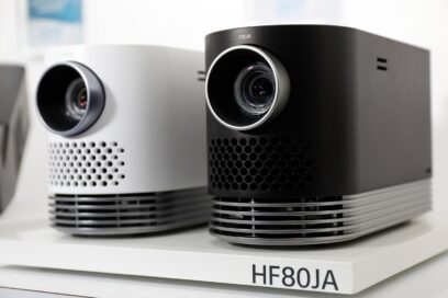 Close-up view of two LG ProBeam HF80JA home projectors on display at LG's CES 2017 booth