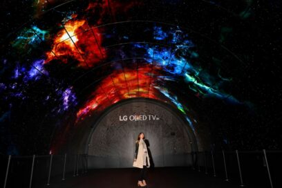 A woman stands under the LG OLED Tunnel which is set up at the entrance of LG's CES 2017 booth.