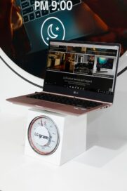 The LG gram laptop computer is weighed on a scale at LG's CES 2017 booth.