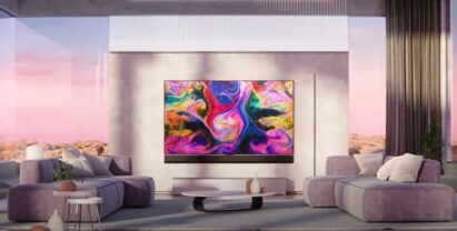 The LG GX Gallery series TV displaying colorful artwork in a modern and open living room