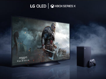 LG OLED TV placed in a dark room filled with mysterious smoke as it displays a battle scene from Assassin's Creed Valhalla, the latest video game available on LG official partner Microsoft's Xbox Series X console which is seen to the right of the TV