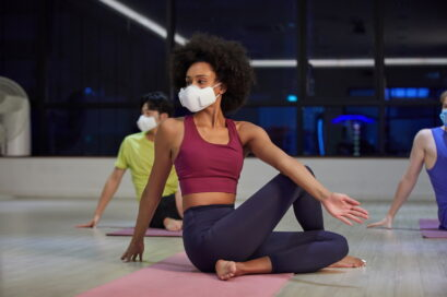 People wearing LG PuriCare™ wearable Air Purifier while stretching